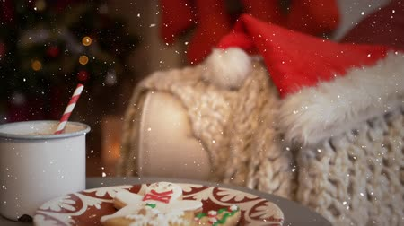 顔写真 : Digital composite of Video composition with falling snow  desk with festive food 動画素材