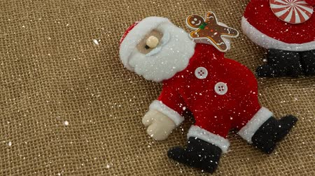 джут : Digital composite of Falling snow with Christmas Santa decoration