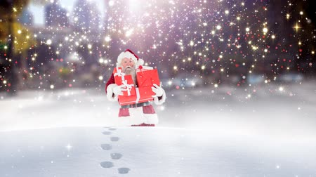 ślady stóp : Digital composite of Santa clause wandering through high snow combined with falling snow