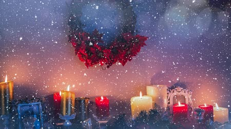 sahte : Digital composite of Falling snow with Christmas candles Stok Video