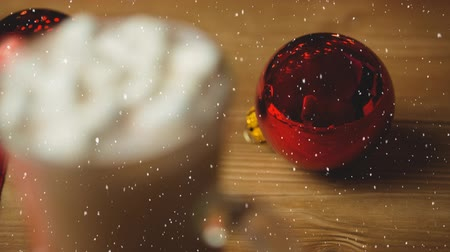 coffee time : Digital composite of Falling snow with Christmas decoration Stock Footage