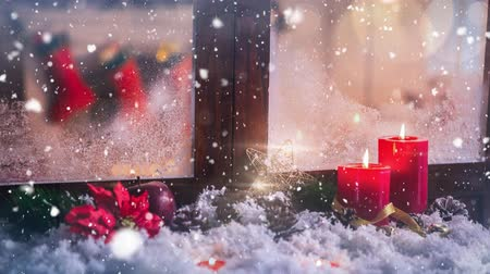 sahte : Digital composite of Candles and christmas decoration outside a window combined with falling snow