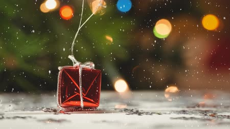 focus on foreground : Digital composite of Falling snow with Christmas gift decoration