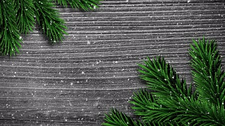 szare tło : Digital composite of Video composition with snow over pine frame on wood