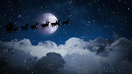 quadro de avisos : Digital composite of Video composition with falling snow  over santa  sleigh over clouds at night