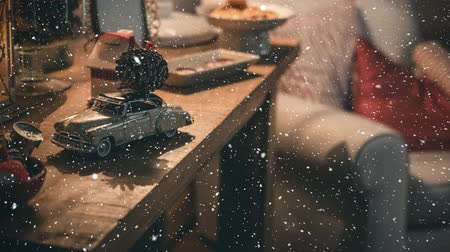 ev gibi : Digital composite of Living room with christmas decoration combined with falling snow