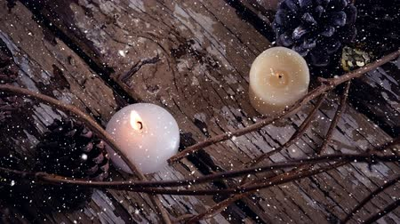 weathered : Digital composite of Falling snow with Christmas candles decoration Stock Footage