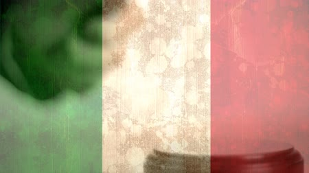 adli : Digitally composite of grunge Italian Flag and gavel. Judges gavel banging against the flag 4k Stok Video