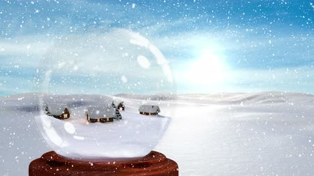 snow globe : Digital animation of illuminated huts against snowy landscape. Snow falling over snow globe 4k