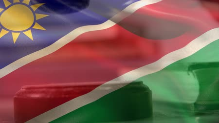 namibya : Digitally composite of Namibia flag. Gavel banging on sounding block 4k Stok Video
