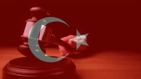 adli : Digital animation of Turkey flag. Judge banging gavel on sounding block 4k Stok Video
