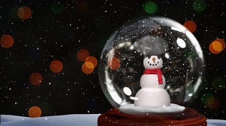 snow globe : Cute Christmas animation of snowman couple against bokeh background. Snow falling over snow globe 4k