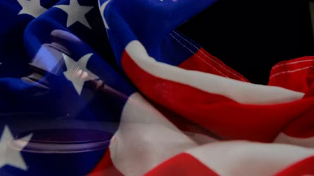 законодательство : Digitally animation of American Flag and gavel. Judges gavel banging against the flag 4k