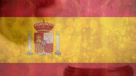 adli : Digitally animation of Spain Flag and gavel. Judges gavel banging against the flag 4k