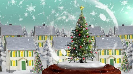 zimní : Beautiful Christmas animation of Christmas tree in the magical village against the snowflakes falling in background. Snow is falling against the village 4k Dostupné videozáznamy