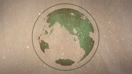 snow globe : Digital animation of earth globe against brown background. Snow is falling over the globe 4k Stock Footage
