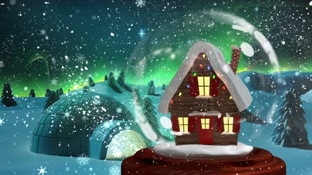 igloo : Christmas animation of Christmas house in snowy landscape. Snowflakes glitter sparkles wave moving in background 4k