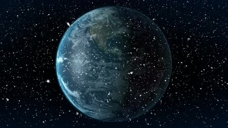 snow globe : Digital animation of earth globe rotating on black background. Snow is falling on foreground 4k