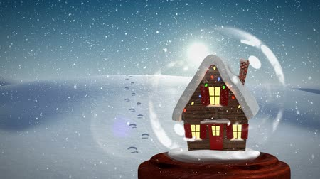 snow globe : Christmas animation of Christmas house on snowy landscape. Snow is falling over sunlight 4k Stock Footage