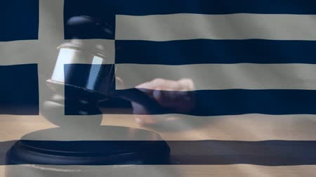 adli : Digitally animation of Greeks Flag and gavel. Judges gavel banging against the flag 4k