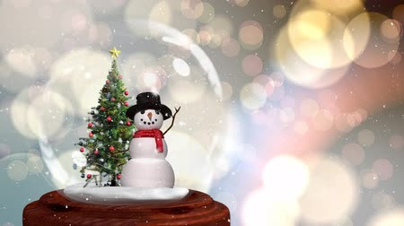kardan adam : Cute Christmas animation of snowman and Christmas tree in snow globe. Snow is falling over glittering background Stok Video