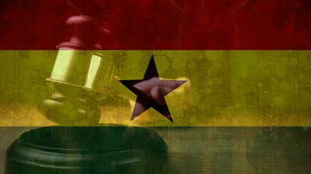 adli : Digitally animation of Ghanaian Flag and gavel. Judges gavel banging against the flag 4k