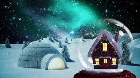 igloo : Christmas animation of hut in snow globe in magical forest. Snow falling over the snow covered landscape 4k Stock Footage