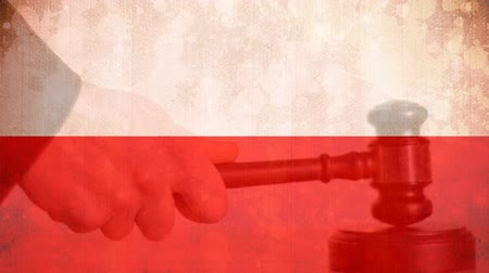 adli : Digitally composite of grunge Poland Flag and gavel. Judges gavel banging against the flag 4k