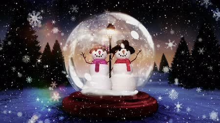 kardan adam : Cute Christmas animation of snowman couple in snow globe in magical forest. Snowflake falling over the forest 4k