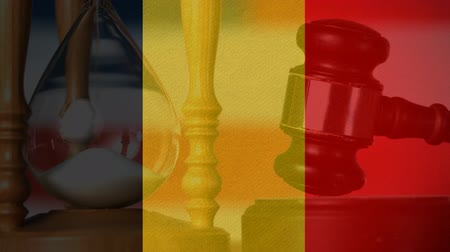 adli : Conceptual digital animation of Belgium flag. Judges gavel banging against the flag 4k