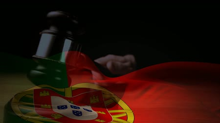 adli : Digitally composite of grunge Portugal Flag and gavel. Judges gavel banging against the flag 4k