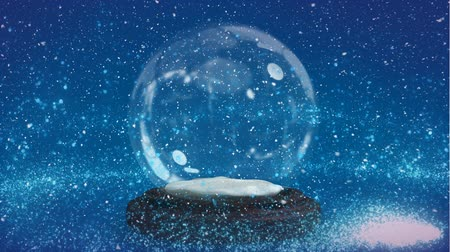 snow globe : Digital animation video of blue glitter sparkles wave moving around snow globe. Snow falling against blue background 4k Stock Footage