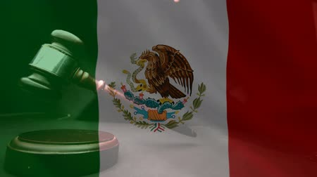 adalet : Digitally composite of grunge Mexican Flag and gavel. Judges gavel banging against the flag 4k