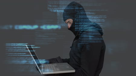 balaclava : Digital animation of hacker using the laptop in data center. Digital binary technology code in background 4k