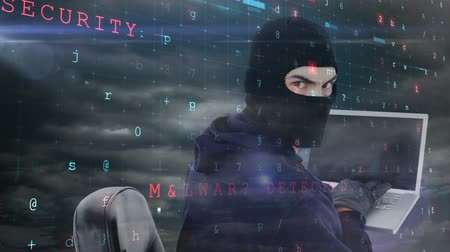 balaclava : Digital animation of hacker hacking the laptop. Digital screen in background 4k Stock Footage