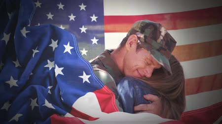 homecoming : Conceptual digital animation showing a child hugging the American soldier on home returning. Swaying American flag in background 4k