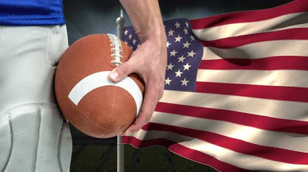 rugby ball : Conceptual digital animation showing defeat of a Rugby player. American flag swaying in background 4k Stock Footage