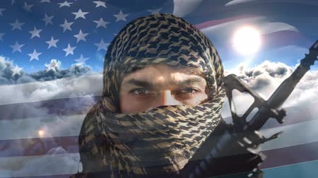 silahlar : Digital animation of terrorist holding rifle against swaying American flag. Clouds moving in the sky 4k