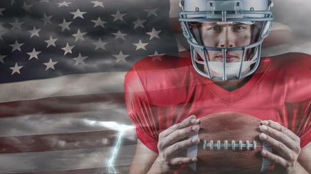 rugby ball : Digital animation of rugby player holding rugby ball. American flag swaying in background 4k