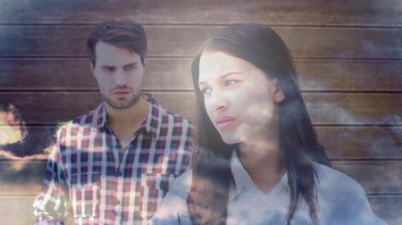 avoiding : Conceptual digital animation showing relationship problems. Couple avoiding each other and white clouds floating across 4K Stock Footage
