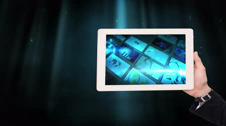 part of the frame : Digital animation of frames of business graphics displayed in tablet. Beams of light on the blue background 4K Stock Footage