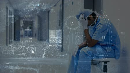 коридор : Digital animation of stressed physician sitting in the hospital corridor. Digital computer interface in foreground 4K