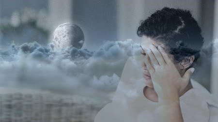 tense : Digital animation of worried woman with hand on head. Moon and white clouds moving in the sky 4K