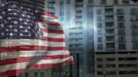 zaklamp : Digital Animation of American flag swaying against the buildings in city. Lights sparkling in between 4K