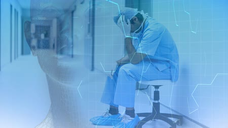 коридор : Digital animation of stressed physician sitting in the hospital corridor. Hexagonal pattern and human interface in foreground 4K