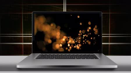 exibindo : Laptop screen displaying golden bokeh lights. Lines forming square on the brown background 4k Stock Footage