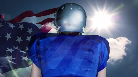 честь : Digital animation of rugby player standing against American flag 4k. American flag swaying in the sky 4k