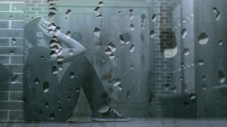 depressão : Digital animation of worried man in corridor. Water dropping in foreground 4k Stock Footage