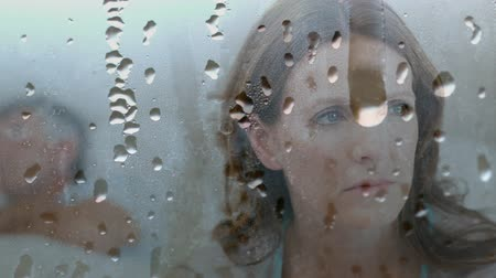 tense : Digital animation of worried woman at home. Water drop falling in foreground 4k