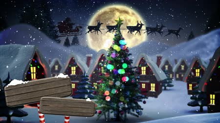 Digitally generated animation of houses and road sign covered in snow. Santa claus passing by against white mountain and big moon background.